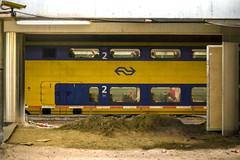 Inge Hoogendoorn (ingehoogendoorn) Tags: station yellow train sand utrecht absurd trains frame framing centraalstation renovation geel trein verbouwing zand treinen absurdism renovatie doorkijkje kadrering