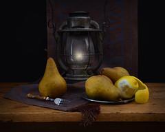 Fruit by Lamplight (njk1951) Tags: stilllife blackbackground fruit lemon pears linen plate fork lantern runner woodtable onblack tablerunner lemonpeel antiquetable boscpears antiquelantern threepears shinyfork pewterplate dessertfork