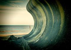 CONCRETE CURVED COASTAL DEFENCE (mrstaff) Tags: lighthouse art beach danger rocks surf waves bright debris norfolk gap dry windy sunny cliffs cart groyne happisburgh coastalerosion seadefense martinstafford january282016