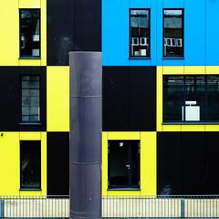 Checkered (uneitzel) Tags: blue geometric window yellow square fenster hamburg gelb blau checkered ibadock olympusem5 mzuiko1250mm