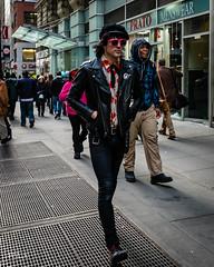 Prato Poppy (ryanlandell) Tags: city nyc people urban woman man black men art hat bag walking photography hoodie women shades jacket fujifilm smirk 16mm 7thave rlx xt1 myfujifilm xf16mmf14 rlxpress