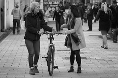 C'mon let me have a go! (Just Ard) Tags: street people blackandwhite bw woman white black blancoynegro girl monochrome face bike bicycle person photography mono nikon noiretblanc zwartwit candid 85mm d750 unposed  biancoenero schwarzundweis