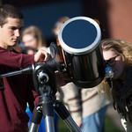 Students looking through telescope.