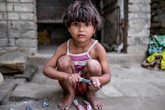 _DSF9459 (travelstreetmodel) Tags: india girl infant child innocent syringe travelphotography outdoorportrait naturallightportrait indiatravelphotography fuji23mm fujixt1 sonepurvillage