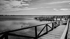 Reflejo de inspiracn (juliosabinagolf.) Tags: bw nature muelle mar agua sony paisaje bn cielo nubes marmenor sombras monocromtico