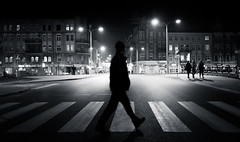 One Looking at Three | Day 231 / 365 (marcin baran) Tags: road street city girls light urban blackandwhite bw white man black monochrome by night composition dark walking person one mono 1 evening three blackwhite fuji darkness pov walk candid stripes pass streetphotography poland polska center stranger human fujifilm passing lamps 365 middle passerby element gliwice candidphotography x100 365project marcinbaran x100t