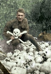 American soldier makes the skull and crossbones symbol with real bones in a mass grave, France, c. 1918 [472680] #HistoryPorn #history #retro http://ift.tt/1pWlteJ (Histolines) Tags: france history grave real soldier skull with symbol c retro american bones timeline makes mass crossbones 1918 vinatage historyporn histolines 472680 httpifttt1pwltej