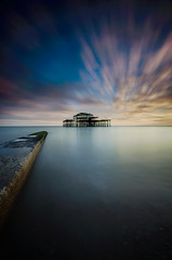 West Pier sunset (KVH-P) Tags: uk nightphotography sunset sea beach water clouds landscape sussex pier lowlight brighton waves seascapes jetty ngc wideangle m slowshutter eastsussex sigma1020mm 2016 travelphotography gitzotripod leefilters uklandscape sussexlandscape beacheslandscapes d7000 cloudsstormssunsetsandsunrises nikond7000 sussexseascape