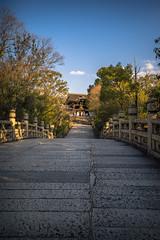 Bridge to a Temple (ErikFromCanada) Tags: bridge sunset sun beautiful japan stone landscape temple kyoto shrine path wide ultra warmlight settingsun a7r