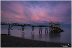 Selsey Lifeboat Station just after Sunset (Sharon Dow Photography) Tags: uk longexposure pink sunset sea england sky seascape beach metal night clouds dark landscape sussex coast boat nikon scenery europe pretty view westsussex britain stones steel tripod peaceful pebbles nighttime lifeboat walkway shore fishingboats boathouse selsey slipway clearsky chichester rnli gangway aftersunset southernengland lifeboathouse 2016 ndfilter lifeboatstation nightskies rnlb royalnationallifeboatinstitute 155yearsold pinkskiesatnight nikond7100 sharondowphotography april2016 selseylifeboatstationjustaftersunset piledplatform