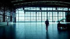 the airoport. (greta.capaldo) Tags: travel blue light shadow portrait color plane waiting loneliness shadows blu glasswindow solitudine airoport soletude iphonesia
