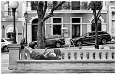 Plaza Coln (JOSEAN GOMEZ) Tags: shadow urban men texture blancoynegro 35mm blackwhite arquitectura oldsanjuan streetphotography textures sidewalk p analogue texturas viejosanjuan lightroom fotocallejera kodakd76 industar22 fotografiacallejera negativo35mm thefilmgroup films35mm epsonperfectionv500scanner aristapremium400 oldsanjuanstreets silverefexpro2
