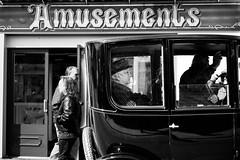 one is not amused (I AM JAMIE KING) Tags: street people black car sign vintage amusement seaside carriage candid gothic profile goth whitby signage fujifilm passenger motorcar whitbygothweekend xpro1