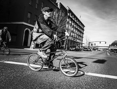 Through The Intersection (TMimages PDX) Tags: road street city people urban blackandwhite monochrome bike bicycle buildings portland geotagged photography photo image streetphotography streetscene sidewalk photograph pedestrians pacificnorthwest biker bicyclist avenue vignette fineartphotography phoneography
