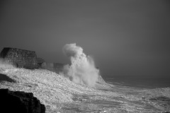 Taking over (Tim Bow Photography) Tags: light lighthouse storm nature water weather wales dark landscape pier dangerous rocks waves power impact british welsh splash swell exciting porthcawl blackandwhitephotography thrilling stormwaves porthcawlpier timboss81 timbowphotography lowtideporthcawlstorms
