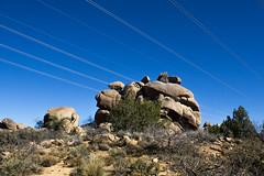 man and nature (Michael Kenan) Tags: arizona sky lines high power desert az boulders tension
