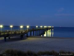 Nachtlichter (Sockenhummel) Tags: ocean winter sea beach night strand licht pier meer wasser fuji nacht balticsea finepix fujifilm rügen ostsee beleuchtung x20 binz küste seebrücke nachtaufnahmen fujix20