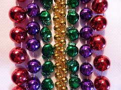 Mardi Gras bead parade (Monceau) Tags: macro beads colorful vivid minimalism mardigras macromondays