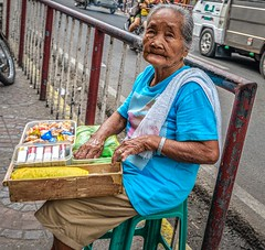 A life working on the streets (FotoGrazio) Tags: poverty street old portrait people woman texture face philippines poor mother streetphotography streetportrait streetscene sidewalk bulacan elderly weathered vendor aged filipina cigarettes candies toothless streetvendor socialdocumentary babae wrinkes travelphotography pacificislanders documentaryphotography fotograzio waynegrazio