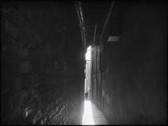 Gadgie almost at the point of vanishing (alanpeu1) Tags: film monochrome mediumformat edinburgh closes analogue stripped oldtown mamiya645 delta400