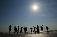 Silhouette (kailas bhopi) Tags: light sunset sea sky reflection silhouette kids fun aperture nikon view action outdoor candid freeze flare sunburst rays 1855 seashore enjoyment konkan malvan wayangani