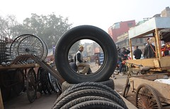 street photography (aviky2k) Tags: street photography new delhi jama masjid shop road tyre circular frame man sitting nice view chandni chowk