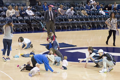 Baby Races - Halftime at BYU Basketball Game (aaronrhawkins) Tags: family baby game college basketball children mom fun utah funny university dad child floor walk entertainment parent laugh mens prize halftime activity races crawl provo lure byu brighamyounguniversity marriottcenter aaronhawkins