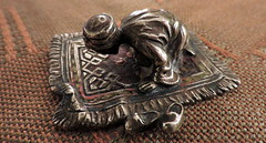 in prayer (D.G-S) Tags: metal bronze islam prayer religion ornament castiron brass magnet patina