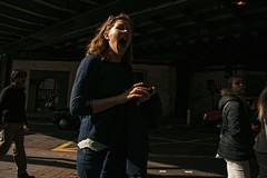 Lioness. (Places, Faces) Tags: street city uk england urban woman color colour london composition shadows britain expression candid centre central yawn streetphotography silhouettes streetscene scene compo streetphoto capture lowkey contorted urbanstreets streetcandid robmchale