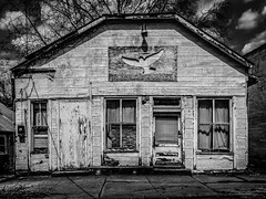 Dove Outreach (tim.perdue) Tags: dove outreach faded sign peeling paint small town rural decay building house abandoned empty deserted broken door window black white bw monochrome old neglect vacant waverly ohio explore popular interestingness interesting