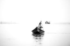 Lone Journey (Raihan Quadir) Tags: blackandwhite river boat child boatman