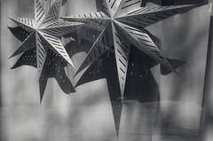 Window Stars (JeffStewartPhotos) Tags: blackandwhite bw toronto ontario canada window paper stars blackwhite scout photowalk queenstreetwest toned parkdale queenstreet westlodge prewalk torontophotowalk topw torontophotowalks westlodgeavenue walkingwithvickii checkingtheroute topwpkdl