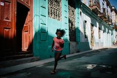 chicheri (Raquel lopez-chicheri) Tags: street colors kid movement shadows child cuba run cuban lahabana cubanos lahabanavieja lahabanasederrumba lahabanaisfallingdown