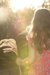 The wonderful world of a child exploring (Caramel Kisses Photography) Tags: pink hair back glow child dress exploring australia adelaide southaustralia sunflare whimsicle