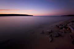 _DSC2204* (Northwoods Photos) Tags: pink blue sky brown nature water up clouds still sand nikon rocks dusk michigan peaceful flowing lakesuperior northwoods afterglow