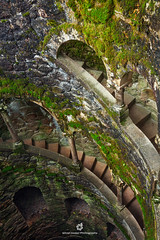 Initiation Well of Quinta da Regaleira (fesign) Tags: old history portugal vertical architecture spiral outdoors photography moss ancient day arch quintadaregaleira sintra tranquility nopeople unescoworldheritagesite well traveldestinations initiationwell colourimage elevatedview builtstructure traditionallyportuguese
