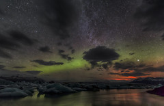 Clouds and Aurora at 05.28am and the light of a volcanic eruption for good measure. (Nick L) Tags: light reflection green ice canon stars landscape eos volcano iceland glacier aurora 5d canon5d eruption northernlights auroraborealis icelandic milkyway 1635 glaciallake glaciallagoon 1635l 1635lii 5d3 canon5d3 eruptionlight icelakeatjkulsrln icelagoonatjkulsrln icelagoonatjokulsarlon