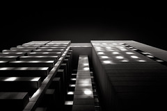 the spotlight can change everything... (Tony Macrellis) Tags: light bw building up lines architecture reflections shadows graphic adelaide blocks cbd speckled speckledlight