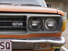 Datsun 180B (ToBoote) Tags: orange emblem logo front bumper headlight datsun 180b