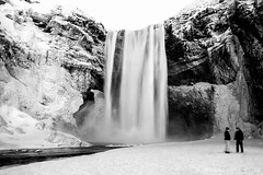 frozen motion in winter wonderland (lunaryuna) Tags: longexposure winter people bw snow ice water monochrome season landscape blackwhite waterfall iceland lunaryuna frozenmotion theenchantmentofseasons skogafosswaterfall seasonalwonders