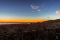 Moonstone Beach-California-Central-Coast 2016-02-08 (randyandy101) Tags: ocean california sunset sea sky panorama sun seascape water clouds fence outdoors photography coast seaside twilight sand surf waves outdoor horizon cliffs coastline cambria lowclouds seagrass goldenhour moonstonebeach californiacentralcoast cambriaca cambriapinesbythesea santarosacreekestuary