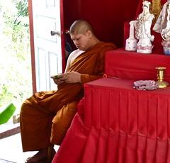 Modern Buddhist monk (Kumukulanui) Tags: modern thailand buddha cellphone monk buddhism mobilephone phuket bigbuddha buddhistmonk
