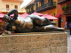 Cartagena, Columbia, Buxom lady in bronze.  = Botero reclining nude. (rossendale2016) Tags: life roof opportunity texture feet beautiful statue stone comfortable lady bronze hair naked nude square concrete foot design town wooden carved big model hands shiny different arms legs artistic fat south large like down stomach columbia curvy tourist photographic brushing well belly thighs american figure fernando balconies reclining delicate lying popular heavy railings cartagena weight plinth plump built polished attraction textured botero hefty intricate photogenic extremely glamorous designed padded stroking buxom depiction lifelike stocky onherside