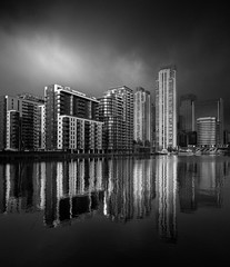 Gotham City (vulture labs) Tags: blackandwhite london clouds skyscraper reflections canarywharf vulturelabs