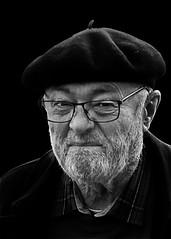 Portrait (D80_428632) (Itzick a way) Tags: man smile smiling blackbackground copenhagen beard denmark glasses candid beret bwportriat