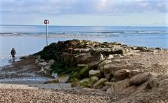 Rocksand (Hodd1350) Tags: christchurch people seascape beach lumix sand rocks waves gulls horizon pebbles panasonic dorset lowtide sandbank warningpole avonbeach lx100