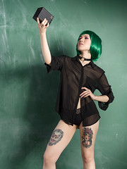 Portrait of a self-portrait 2 (Bruce M Walker) Tags: camera green fashion tattoos wig chalkboard sheer kodakbrownie