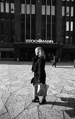 Sunshine & snow portrait (Emptiness of Helsinki) Tags: snow sunshine lady contrast finland helsinki europe candid streetphotography surreal streetportrait figure lone nordic ilford fp4 climate harsh pushprocess selfdeveloped perceptol