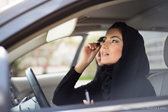 Middle Eastern Woman Applying Make-up (ImagineWhat) Tags: people woman beautiful beauty car lady clothing driving sitting steering traditional uae makeup style move arabic arab transportation arabia driver inside arabian putting abaya garment applying emirati middleeasternethnicity middleeasternculture