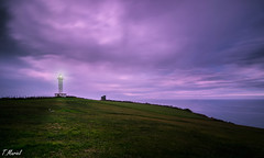 Ocaso sobre el Faro / Sunset over the lighthouse (tmuriel67) Tags: longexposure sunset sky espaa lighthouse seascape colors faro outdoors spain nikon flickr asturias colores nubes cielos ocaso lastres largaexposicion ndfilters